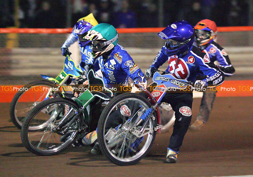 Arena Essex Hammers vs Poole Pirates - Elite League 'A' - 24/03/06 - Heat 3 - Leigh Lanham (blue) on his way to victory ahead of Grzegorz Walasek (green), Antonio Lindback and Henning Bager - (Gavin Ellis 2006)