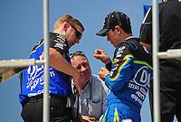 Sept. 26, 2008; Kansas City, KS, USA; Nascar Sprint Cup Series driver Joey Logano (right) talks with crew chief Steve Boyer during practice for the Camping World RV 400 at Kansas Speedway. Mandatory Credit: Mark J. Rebilas-