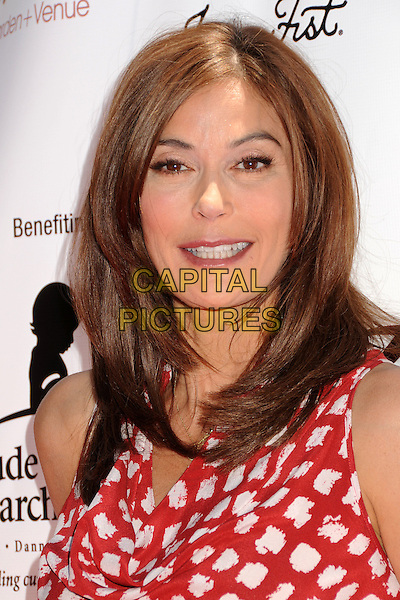 TERI HATCHER .Teri Hatcher's Red Carpet Yard Sale benefiting St. Jude Children's Research Hospital and Rockstar Education held at Tiato Garden, Santa Monica, California, USA..May 1st, 2011.headshot portrait red white polka dot print  .CAP/ADM/MJT.© MJT/AdMedia/Capital Pictures.