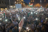 People participate with mobile lights in a demonstration against the outcome of the general elections in Budapest, Hungary on April 21, 2018. ATTILA VOLGYI