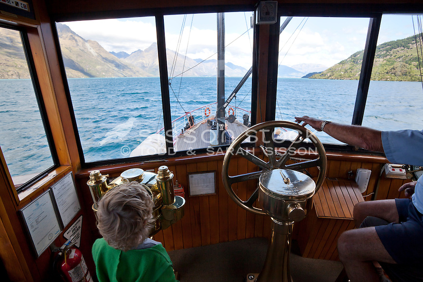 Little boy standing in the wheelhouse of the TSS Earnslaw, Queenstown, South Island