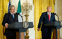 United States President Donald J. Trump, right, and Prime Minister Paolo Gentiloni of Italy, left, conduct a joint press conference in the East Room of the White House in Washington, DC on Thursday, April 20, 2017.<br /> CAP/MPI/RS<br /> &copy;RS/MPI/Capital Pictures
