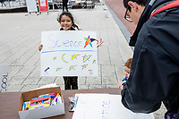 Laila Ozat-McIntyre, 7, of Malden, Mass., displays a sign she made at the March for Science demonstration in Harvard University's Science Center Plaza in Cambridge, Massachusetts, on Sat., April 22, 2017. Ozat-McIntyre's father is a student at Harvard's Graduate School of Education.