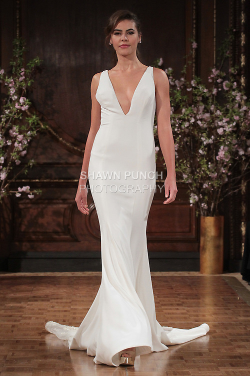 """Model walks runway in a """"Storm"""" bridal gown from the Isabelle Armstrong Spring Collection 2017, at Lotte New York Palace Hotel, during New York Bridal Fashion Week Spring Summer 2017 on April 16, 2017."""