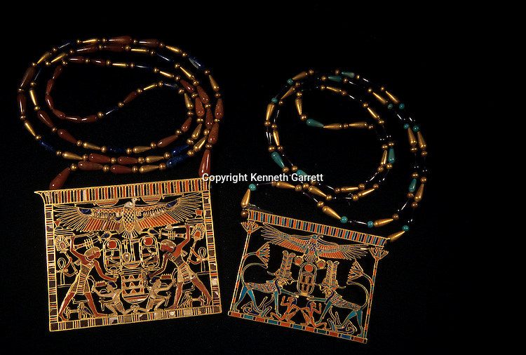 Two necklaces with attached illustrated pectorals made of  gold, carnelian, turquoise, lapis lazuli and amethyst. (Left) Pectoral in the name of Amenemhat III, pharaoh with war club holding hair of Asiatic Bedouin, vulture goddess Nekhbet; (Right) Pectoral in name of Senusret III, falcon-headed sphinxes represent pharaoh defeating Egypt's enemies, lotus plant frame scene