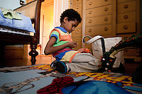 8 year-old Danny Hodes, an Ethiopian boy taken in by Marilyn Berger (not pictured), the widow of Don Hewitt, plays in his bedroom in New York, NY, USA, 9 April 2010. Ms Berger met him in Addis Ababa while reporting there and helped him get surgery.