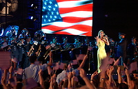 "May 2, 2002,FORT LAUDERDALE, Fla USA (AFIE) <br /> <br /> Members of the Band of the U.S. Air Force Reserve perform the song ""God Bless America"" with singer Celine Dion on May 2, during the filming of the CBS prime-time special called """"Rockin' the USA -- A Salute to the U.S. Military,"" which will air May 25 on CBS. <br /> <br /> <br /> (Mandatory Credit: U.S. Air Force photo)"