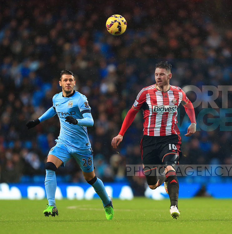 Martin Demichelis of Manchester City and Connor Wickham of Sunderland - Manchester City vs. Sunderland - Barclay's Premier League - Etihad Stadium - Manchester - 28/12/2014 Pic Philip Oldham/Sportimage
