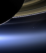 """In this rare image taken on July 19, 2013, the wide-angle camera on NASA's Cassini spacecraft has captured Saturn's rings and our planet Earth and its moon in the same frame. It is only one footprint in a mosaic of 33 footprints covering the entire Saturn ring system (including Saturn itself). At each footprint, images were taken in different spectral filters for a total of 323 images: some were taken for scientific purposes and some to produce a natural color mosaic. This is the only wide-angle footprint that has the Earth-moon system in it.  The dark side of Saturn, its bright limb, the main rings, the F ring, and the G and E rings are clearly seen; the limb of Saturn and the F ring are overexposed. The """"breaks"""" in the brightness of Saturn's limb are due to the shadows of the rings on the globe of Saturn, preventing sunlight from shining through the atmosphere in those regions. The E and G rings have been brightened for better visibility.  Earth, which is 898 million miles (1.44 billion kilometers) away in this image, appears as a blue dot at center right; the moon can be seen as a fainter protrusion off its right side. An arrow indicates their location in the annotated version.  The other bright dots nearby are stars.  This is only the third time ever that Earth has been imaged from the outer solar system.  This view looks toward the unilluminated side of the rings from about 20 degrees below the ring plane.  Images taken using red, green and blue spectral filters were combined to create this natural color view. The images were obtained with the Cassini spacecraft wide-angle camera on July 19, 2013 at a distance of approximately 753,000 miles (1.212 million kilometers) from Saturn, and approximately 898.414 million miles (1.445858 billion kilometers) from Earth. Image scale on Saturn is 43 miles (69 kilometers) per pixel; image scale on the Earth is 53,820 miles (86,620 kilometers) per pixel. The illuminated areas of neither Earth nor the Moon are resolved here."""