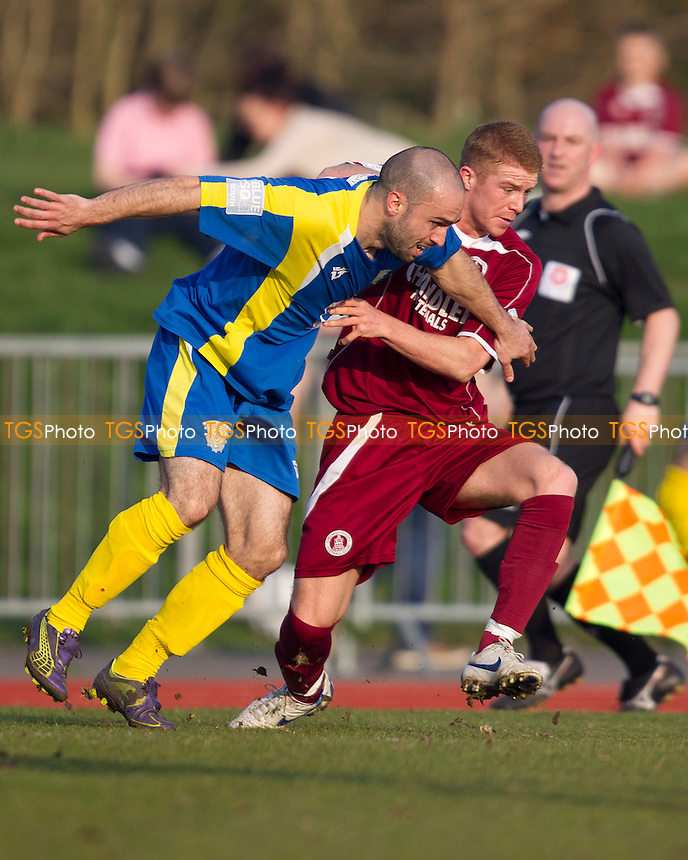 Matthew Warner of Basingstoke Town and Alex Osborn of Chelmsford City get to grips with eachother - Chelmsford City vs Basingstoke Town - Blue Square Conference South Football at Melbourne Park Stadium, Chelmsford - 24/03/12 - MANDATORY CREDIT: Ray Lawrence/TGSPHOTO - Self billing applies where appropriate - 0845 094 6026 - contact@tgsphoto.co.uk - NO UNPAID USE.