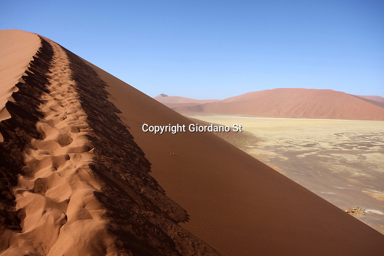 Sossusvlei, NAMIBIA - 3 December 2011 - Tracks of the multitude of tourists who clamour atop Dune 45 near Namibia's famed Sossusvlei in the Namib desert. Picture: Giordano Stolley/Allied Picture Press APP