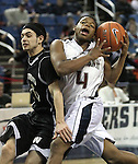 Agassi Prep's Terell Kemp tries to hold onto a loose ball against West Wendover defender Avery Arrien during the NIAA 2A State Basketball Championship game between West Wendover and Agassi Prep high schools at Lawlor Events Center, in Reno, Nev, on Saturday, Feb. 25, 2012. .Photo by Cathleen Allison