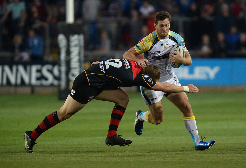 Ospreys Andrew Bishop is tackled by Newport Gwent Dragons Jack Dixon<br /> <br /> Photographer Ian Cook/CameraSport<br /> <br /> Rugby Union - Guinness PRO12 - Newport Gwent Dragons v Ospreys - Friday 12th September 2014 - Rodney Parade - Newport<br /> <br /> &copy; CameraSport - 43 Linden Ave. Countesthorpe. Leicester. England. LE8 5PG - Tel: +44 (0) 116 277 4147 - admin@camerasport.com - www.camerasport.com