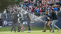 The celebrations begin as Matthew Fitzpatrick (ENG) is sprayed with champagne by his ISM management staff after winning the Final Round of the British Masters 2015 supported by SkySports played on the Marquess Course at Woburn Golf Club, Little Brickhill, Milton Keynes, England.  11/10/2015. Picture: Golffile | David Lloyd<br /> <br /> All photos usage must carry mandatory copyright credit (© Golffile | David Lloyd)