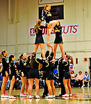 13 February 2011: University of Vermont Catamount Cheer Team entertain the crowd during a game against the Binghamton University Bearcats at Patrick Gymnasium in Burlington, Vermont. The Catamounts came from behind to defeat the Bearcats 60-51 in their America East matchup. The Cats took part in the National Pink Zone Breast Cancer Awareness Program by wearing special white jerseys with pink trim. The jerseys were auctioned off following the game with proceeds going to the Vermont Cancer Center. Mandatory Credit: Ed Wolfstein Photo