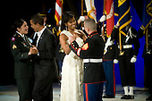 Washington, DC - January 20, 2009 -- United States President Barack Obama and first lady Michelle Obama share a dance with two enlisted service members at the Commander-in-Chiefs Ball at the National Building Museum, Washington, D.C., Tuesday, January 20, 2009. The ball honored Americas service members, families the fallen and wounded warriors. .Credit: Chad J. McNeeley - DoD via CNP