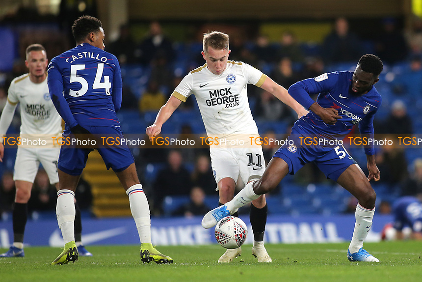 Martell Taylor-Crossdale of Chelsea and Peterborough's Louis Reed challenge for the ball during Chelsea Under-21 vs Peterborough United, Checkatrade Trophy Football at Stamford Bridge on 9th January 2019