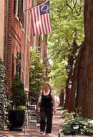 Irene Kupelyan or Armenia walks on a cobblestone sidewalk in the society hill section of the city June 8, 2004 in Philadelphia, Pennsylvania.  (Photo by William Thomas Cain/For The Times)