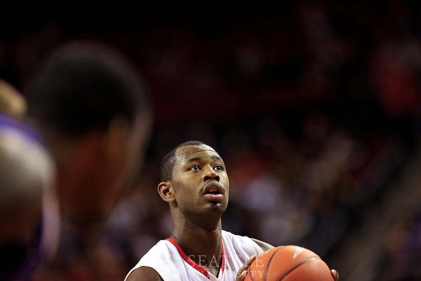 12132012-  Seattle University vs. University of Washington - Men's basketball - 2nd half<br /> <br /> Seattle University's Clarence Trent, focuses on shooting a free throw during the second half of play.