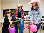 WATERTOWN, CT-28 October 2014-102814EC05--    6-year-old Ava Sisk walks through a wild west themed classroom Tuesday night, part of Watertown High School's annual Safe Halloween. Students Paula Atallah and Doris Selmani wore western themed outfits. Watertown Honor Society students decorated 13 rooms inside the high school, each with a different theme, and handed out candy to children. Erin Covey Republican-American