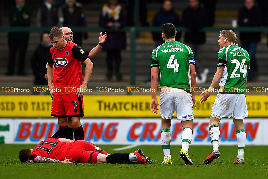 Referee Charles Breakspear  orders Craig Alcock of Yeovil Town (24) right to leave the field after receiving a red card for a second bookable offence  during Yeovil Town vs Grimsby Town, Sky Bet EFL League 2 Football at Huish Park on 9th February 2019