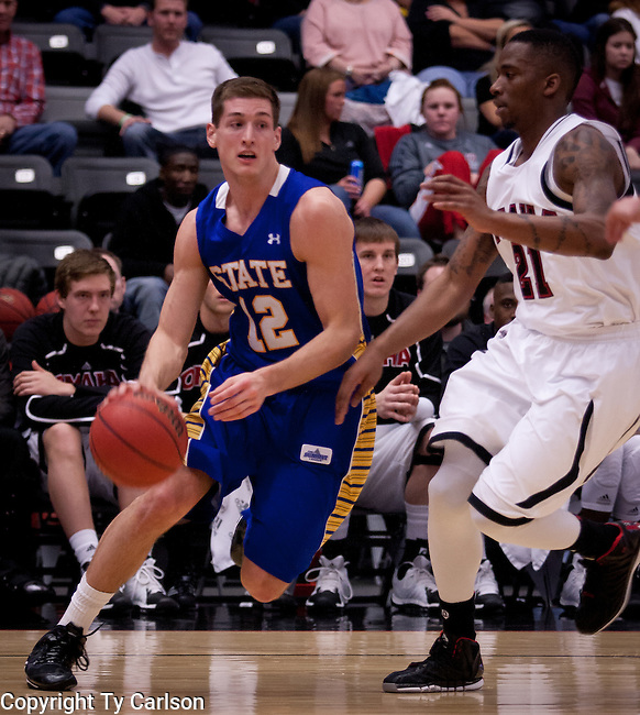 OMAHA, NE - South Dakota State's Brayden Carlson #12 drives around University of Nebraska at Omaha defender Justin Simmons #21 during their game Thursday evening at Ralston Arena in Omaha, NE. (Photo By Ty Carlson/DakotaPress.org)