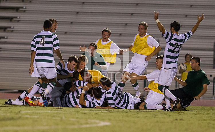 Number 8 ranked Charlotte beats number 16 ranked Coastal Carolina 1-0 on a goal by Thomas Allen in the 101st minute during the second overtime.  Charlotte players celebrate their winning goal in the second overtime.