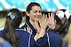 Katy Rebollo of St. Dominic gets congratulated after rolling a strike in the CHSAA girls' bowling championship against St. John the Baptist at Farmingdale Lanes on Thursday, Feb. 4, 2016.