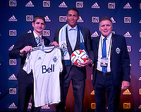 #3 overall pick Christian Dean stands with Vancouver head coach Carl Robinson (left) and president Bob Lenarduzzi (right) during the MLS SuperDraft at the Pennsylvania Convention Center in Philadelphia, PA, on January 16, 2014.