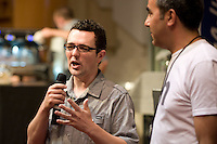 MELBOURNE, AUSTRALIA - JANUARY 09: David Makin commenting at the 2011 Victorian Barista Championship held at St Kilda Town Hall on January 9, 2011 in Melbourne, Australia. (Photo by Sydney Low / Asterisk Images)