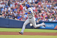 Chicago Cubs shortstop Starlin Castro (13) runs to second during a game against the Atlanta Braves on July 18, 2015 in Atlanta, Georgia. The Cubs defeated the Braves 4-0. (Tony Farlow/Four Seam Images)
