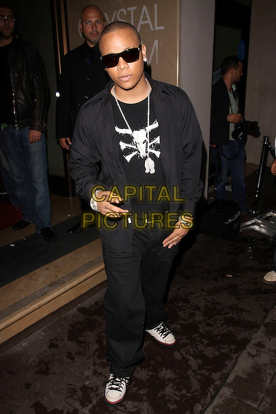 DJ IRONIK (James Charters).The MOBO Awards 2009 Nominations Launch at The Mayfair Hotel, London, England. .August 26th, 2009 .mobos full length black jacket sunglasses shades hand v peace sign silver watch necklace print jeans denim .CAP/AH.©Adam Houghton/Capital Pictures.
