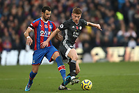 3rd November 2019; Selhurst Park, London, England; English Premier League Football, Crystal Palace versus Leicester City; Luka Milivojevic of Crystal Palace challenges Harvey Barnes of Leicester City  - Strictly Editorial Use Only. No use with unauthorized audio, video, data, fixture lists, club/league logos or 'live' services. Online in-match use limited to 120 images, no video emulation. No use in betting, games or single club/league/player publications