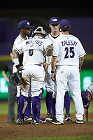 Winston-Salem Dash pitching coach Matt Zaleski (25) has a meeting on the mound with relief pitcher Danny Dopico (22), catcher Yermin Mercedes (6), and third baseman Yeyson Yrizarri (2) during the game against the Myrtle Beach Pelicans at BB&T Ballpark on August 6, 2018 in Winston-Salem, North Carolina. The Dash defeated the Pelicans 6-3. (Brian Westerholt/Four Seam Images)