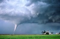 A slender white tornado threatens a farmstead. Stuart Nebraska, June 9th, 2003. (dig comp)