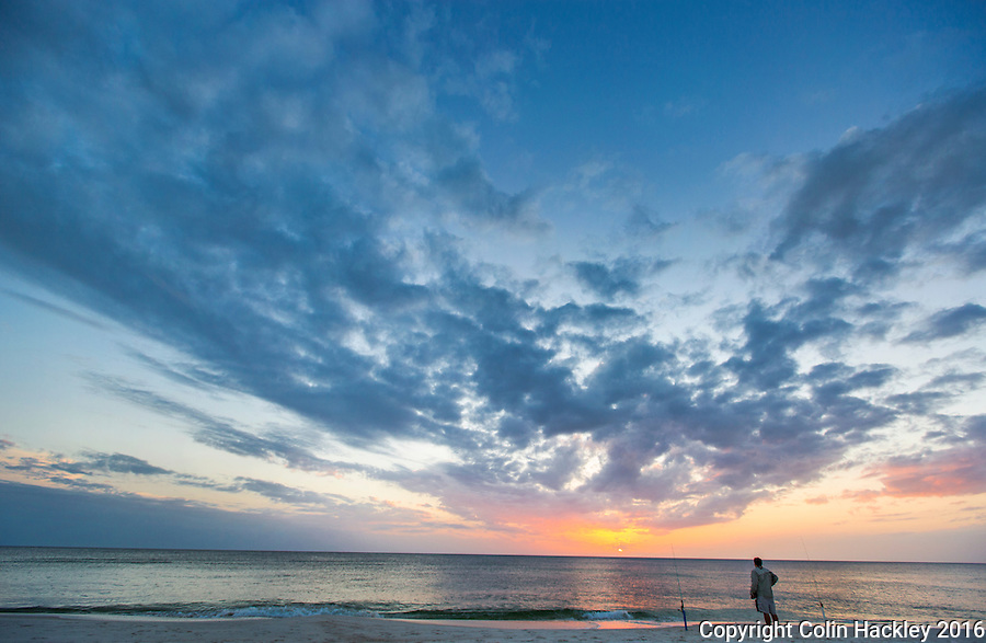 CAPE SAN BLAS, FLA. 4/16/16-A fisherman pauses to watch the sunset at T. H. Stone Memorial St. Joseph Peninsula State Park on Cape San Blas, Fla.<br /> <br /> COLIN HACKLEY PHOTO