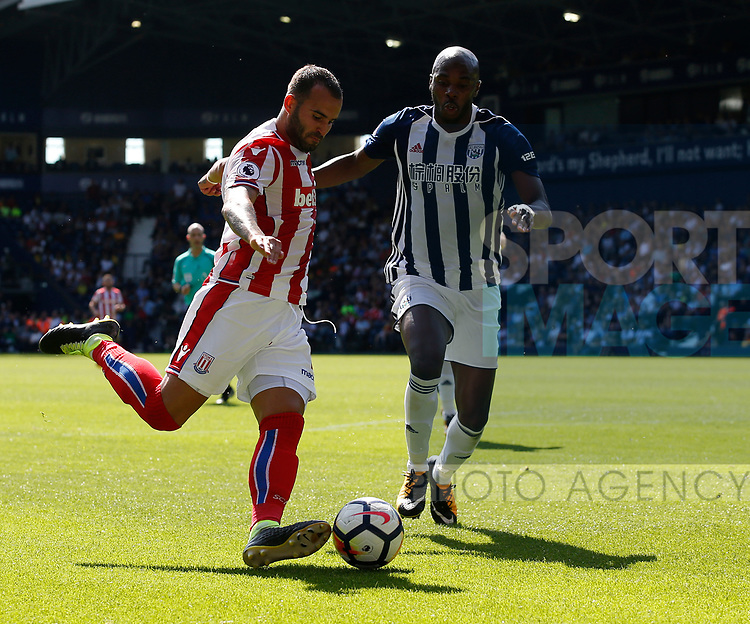Jese of Stoke City and Allan-Romeo Nyom of West Bromwich Albion  during the premier league match at the Hawthorn's Stadium, West Bromwich. Picture date 27th August 2017. Picture credit should read: Simon Bellis/Sportimage