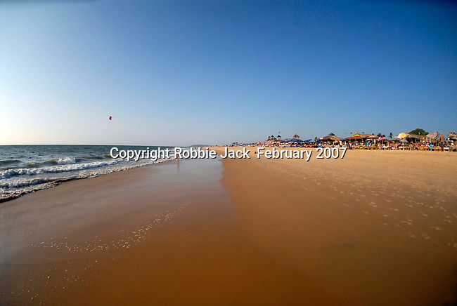 Looking North from the beach at Candolim in Goa in India.