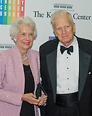 James H. Billington and his wife, Marjorie, arrive for the formal Artist's Dinner honoring the recipients of the 2013 Kennedy Center Honors hosted by United States Secretary of State John F. Kerry at the U.S. Department of State in Washington, D.C. on Saturday, December 7, 2013. The 2013 honorees are: opera singer Martina Arroyo; pianist,  keyboardist, bandleader and composer Herbie Hancock; pianist, singer and songwriter Billy Joel; actress Shirley MacLaine; and musician and songwriter Carlos Santana.<br /> Credit: Ron Sachs / CNP