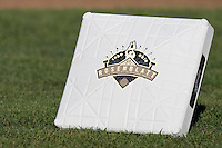 College World Series logo on a base at Johnny Rosenblatt Stadium in Omaha, Nebraska.  (Photo by Andrew Woolley / Four Seam Images)