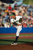 Hillsboro Hops starting pitcher Luis Frias (19) follows through on his delivery during a Northwest League game against the Salem-Keizer Volcanoes at Ron Tonkin Field on September 1, 2018 in Hillsboro, Oregon. The Salem-Keizer Volcanoes defeated the Hillsboro Hops by a score of 3-1. (Zachary Lucy/Four Seam Images)