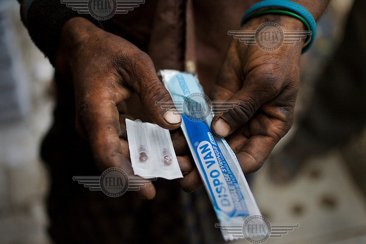 Single-use syringes are handed out at the Sharan Centre in Delhi's Old City, a drop-in centre for Intravenous Drug Users who live on the streets. It sees around 200 people a day, providing them with food, substitute drugs, clean needles, basic medical help and counselling. ..