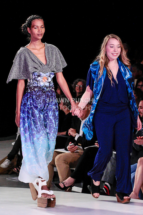 Graduating fashion student Hannah Ross, walks runway with model at the close of the 2013 Pratt Institute Fashion Show, on April 25, 2013.