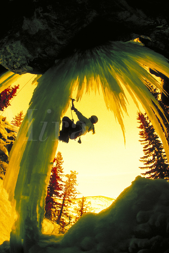 Woman ice climbing in Rocky Mountains, CO - photo in infrared color. Jody Thompson (MR 432). East Vail, Colorado.