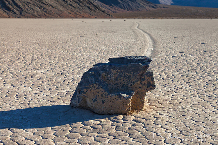 The trail left by a moving rock on the Racetrack Playa in Death Valley National Park is evidence of the rocks motion across the playa. The Racetrack Playa is known for its 'sailing stones' which are rocks that mysteriously move across its surface.
