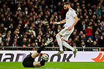 Karim Benzema of Real Madrid and Unai Simon of Athletic Club during La Liga match between Real Madrid and Athletic Club de Bilbao at Santiago Bernabeu Stadium in Madrid, Spain. December 22, 2019. (ALTERPHOTOS/A. Perez Meca)
