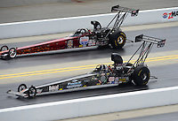 Apr. 14, 2012; Concord, NC, USA: NHRA top alcohol dragster driver John Finke (near lane) races alongside Chase Copeland during qualifying for the Four Wide Nationals at zMax Dragway. Mandatory Credit: Mark J. Rebilas-