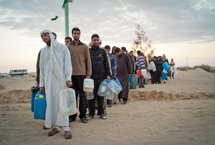 Libyan men queue for petrol at the gas station between Ajdabiya and Benghazi, Libya.
