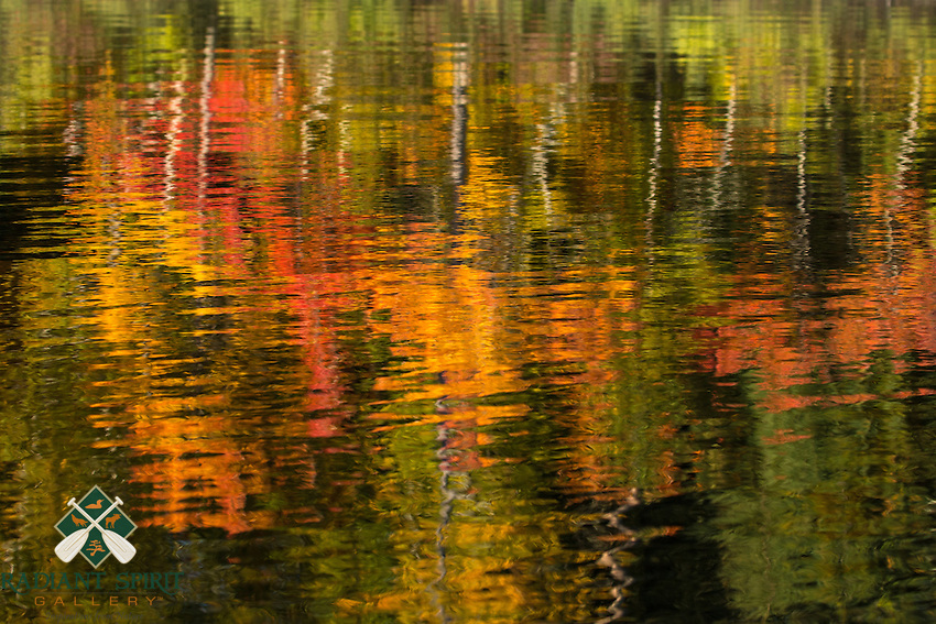 &quot;Fall Color Abstracts I&quot;<br /> <br /> The reflections of the autumn shoreline shimmering on the lake are as beautiful as the forest itself.<br /> ~ Day 187 of Inspired by Wilderness: A Four Season Solo Canoe Journey