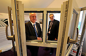 this image is FREE to USE - Alex Neil - Cabinet Secretary for Infrastructure and Capital Investement - photographed with Principal Stewart McKillop (right) viewing a new technology triple glazing sample - at Aurora House (the South Lanarkshire College specialist Eco-house) at the start of the Greener Homes Summit being hosted at the College today. Mr Neil welcomed representatives from Scotland's house-building industry and financial institutions to discuss how to provide more affordable eco-friendly homes in Scotland - for further information please contact Iain V Monk - Scottish Government Senior Communications Officer - on 07771 555 601 - picture by Donald MacLeod  23.11.11  clanmacleod@btinternet.com 07702 319 738 donald-macleod.com